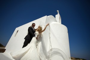 The beautiful young couple in santorini in a wedding dress